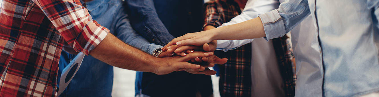 Group of people displaying teamwork with hands