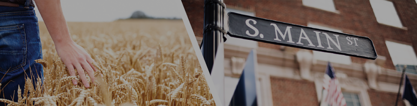 Farmer in wheat field and South Main Street sign