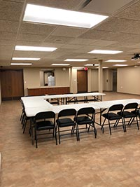 Medford community room showing tables and chairs